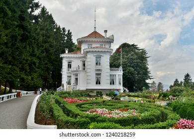 Trabzon, Turkey - September 8, 2018. Exterior view of Ataturk Mansion in Trabzon, with vegetation and people.