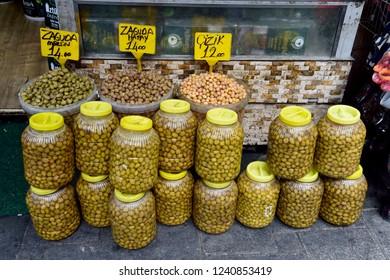 Trabzon, Turkey - September 8, 2018. Buckets and jars of green olives on Trabzon market.