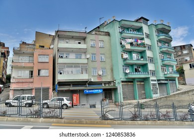 Trabzon, Turkey - September 8, 2018. Residential buildings in Trabzon, with commercial properties and cars.