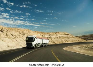 Trac driving on desert road.
