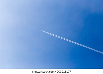trace of the aircraft in the blue sky