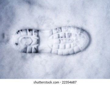 Trace of footwear on white snow