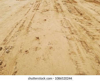 trace of wheels on the sand