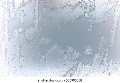 tracery of frost on window. winter miracle