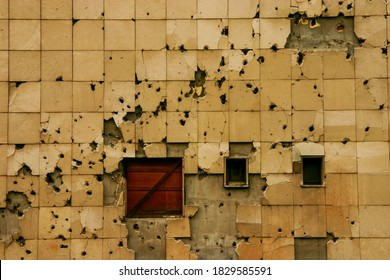 Traces of the Bosnian War, Bullet holes on wall of building in Sarajevo, Bosnia and Herzegovina - Shutterstock ID 1829585591