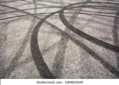Traces of braking from rubber tyres on cement, black tire track skid mark