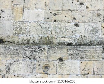 Traces of bullets on fortress wall. Bullet hole background.