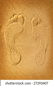 Traces of the feet in the sand