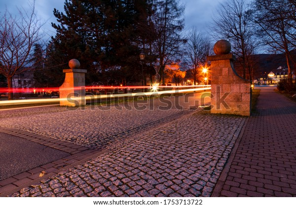 Traces of light in the night at the park in town Ilsenburg