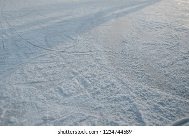 Traces of skates on the ice of skating-rink. background