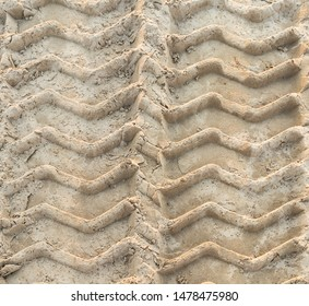 Traces of tread construction equipment on the sand. Bulldozer tread. Top view.