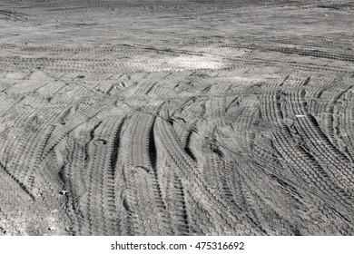 Traces of trucks on the black ground