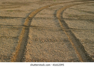 Traces from wheels on stony soil. Natural background