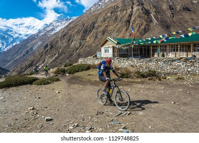 Track around Annapurna, Nepal-06.04.2018: Cyclists from New Zealand on the mountain trail 6 April 2018 on the track around Annapurna, Nepal.