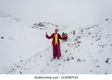 Track around Annapurna, Nepal-07.04.2018: a Young monk on The snowy Thorong La pass on April 7, 2018 on the track around Annapurna, Nepal.