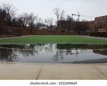 track and artificial grass with very large water puddle