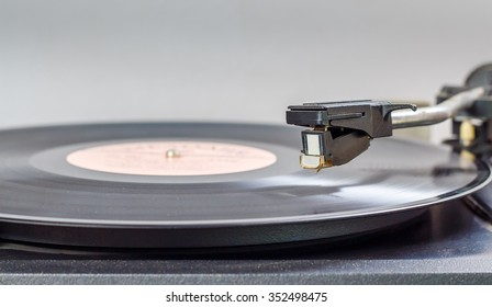 track from black vinyl. Turntable playing vinyl close up with needle on the record