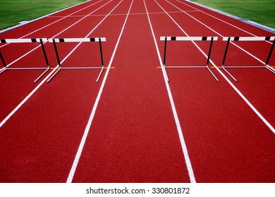 the track field for athlete running with obstacle