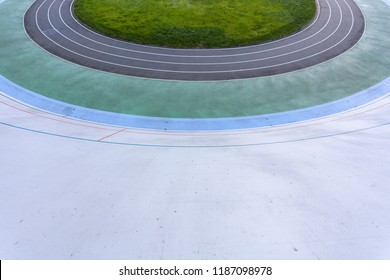 Track and field concept. High angle top view cropped photo of new empty modern public bicycle asphalt track in the open air with colored paths for practice, playing sports