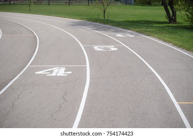 A track and field course with printed numbers