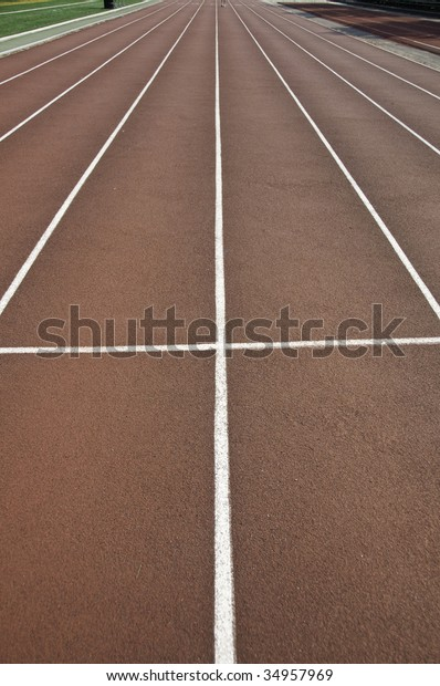 Track and field lanes in a stadium.