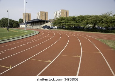 Track and field lanes in a stadium.This is the a turn coming up.