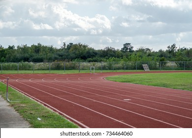 Track and field red clay at a high school stadium