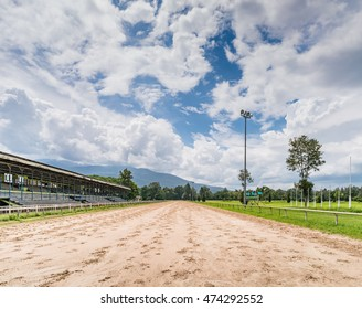 Track of racecourse with old wooden grandstand