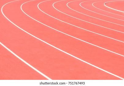 Track running, red treadmill at the stadium