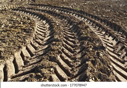 Track of a tractor on a plowed field