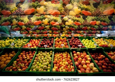 Tracking (dolly) shot moving past fruit in a supermarket grocery. Includes red apples, green apples, lemons, etc.