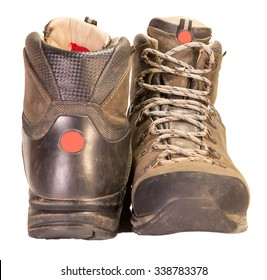 Tracking the old brown leather boots isolated on white background.