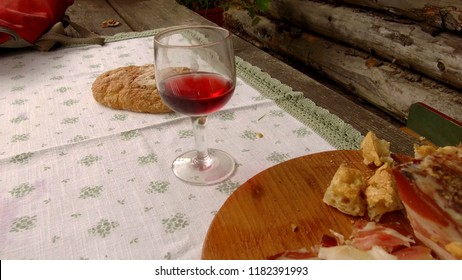 tracking shot on a table of a cabin with speck and dry bread, typical Tyrolean dish
