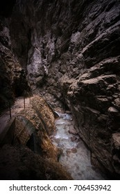 Tracking trail with railings in the Partnach Gorge in Alpes, Bavaria, Germany .