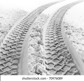 Tracks of a heavy vehicle in white snow
