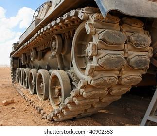 Tracks of the Israeli Magach tank in the desert closeup