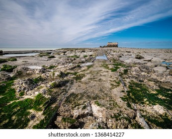 Tracks leading through rocks towards the Fort de l'Heurt on the waterline at Le Portel, France