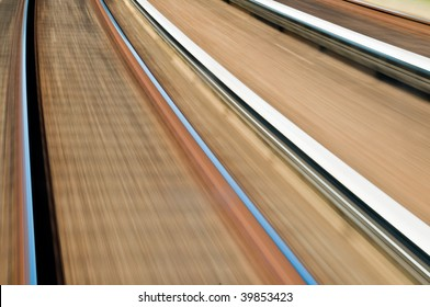 tracks in motion racing by underneath