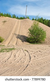 Tracks on sand and sand hill in countryside