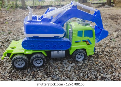tracktor on truck  land outside in ground lifstle of children playing toy with car on background