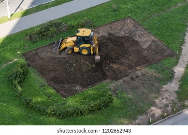Tracktor preparing site for new building