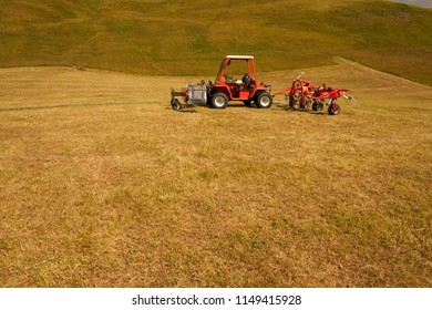 Tracktor in the swiss alps. Topic: Mountain farmer.
