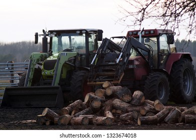Tracktors on the farm with wood for the fireplace