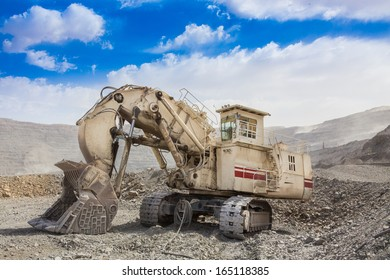 track-type loader excavator machine  at the opencast mining