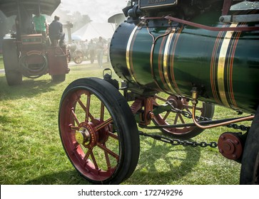 A traction engine parade at a steam rally.