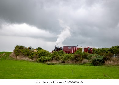 A traction engine towing cabins works its way up the Waimakariri Gorge Road heading towards Sheffield, New Zealand
