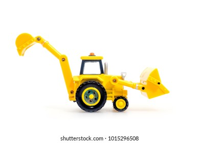 Tractor with backhoe and loader toy isolated on white bacground . Children's Developmental, creative thinking toy car.