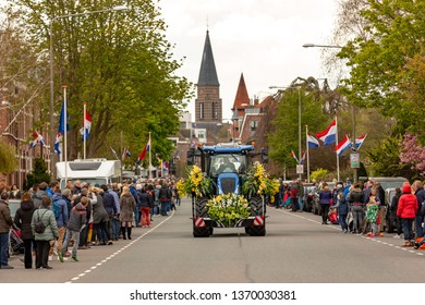 A tractor with beautifull flowers and of spectators at the annual bloemencorso bulb flower parade in the Hoofdstraat in the dutch village of Sassenheim. On saturday 13 april 2019.