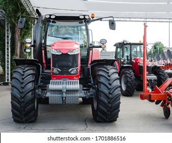 tractor with big wheels, machine for agricultural work and transportation of goods, exhibition sale, Kiev, Ukraine, June 2019