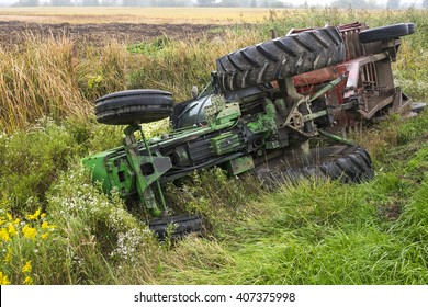A tractor and cart from a local farm lay in a ditch after rolling off a road in Ontario Canada.